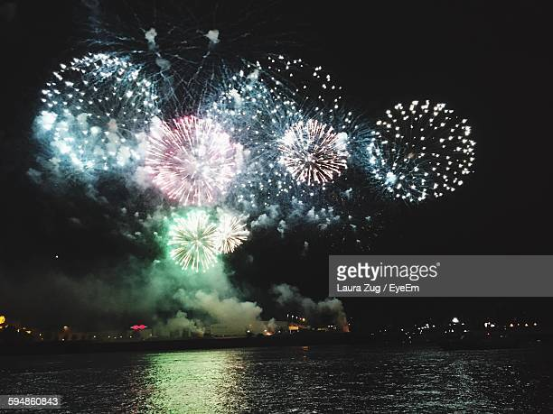 Low Angle View Of Firework Display In Sky Over Sea