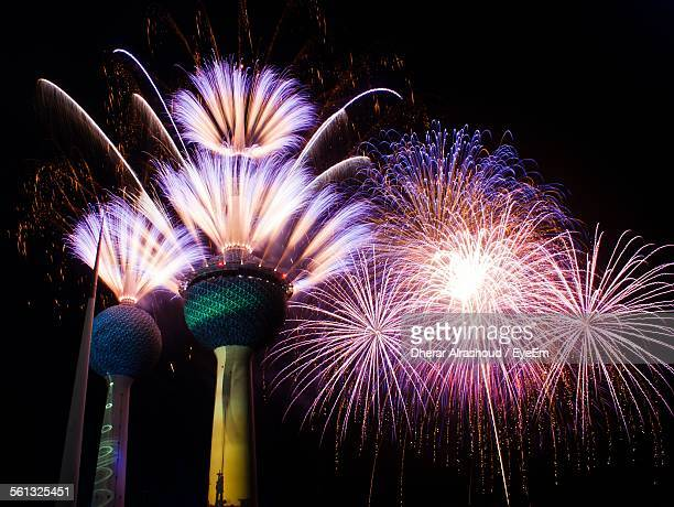 Low Angle View Of Firework Display Over Kuwait Towers At Night
