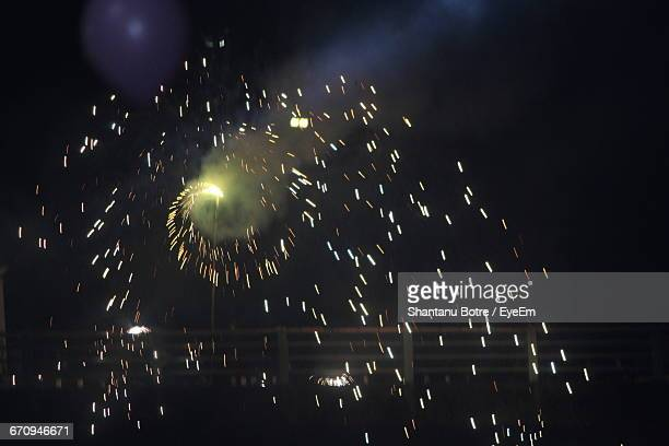 Low Angle View Of Firework Exploding Against Sky
