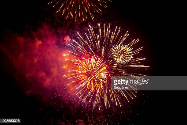 low angle view of firework exploding in sky - fireworks stock pictures, royalty-free photos & images