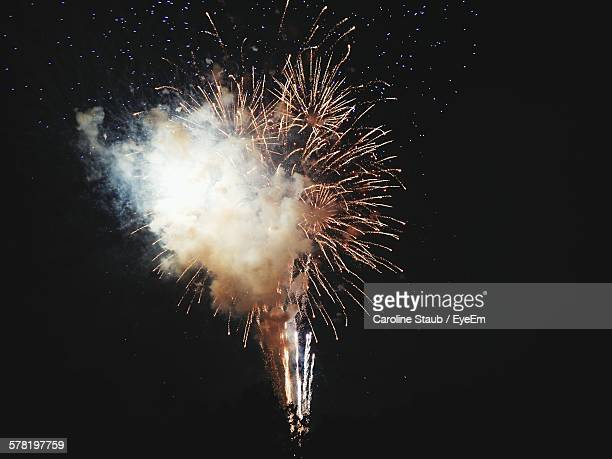 Low Angle View Of Fireworks Exploding At Night