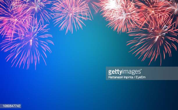 low angle view of fireworks in sky - fireworks stock pictures, royalty-free photos & images