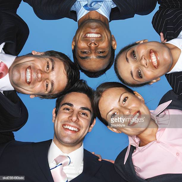 Low angle view of five business executives smiling