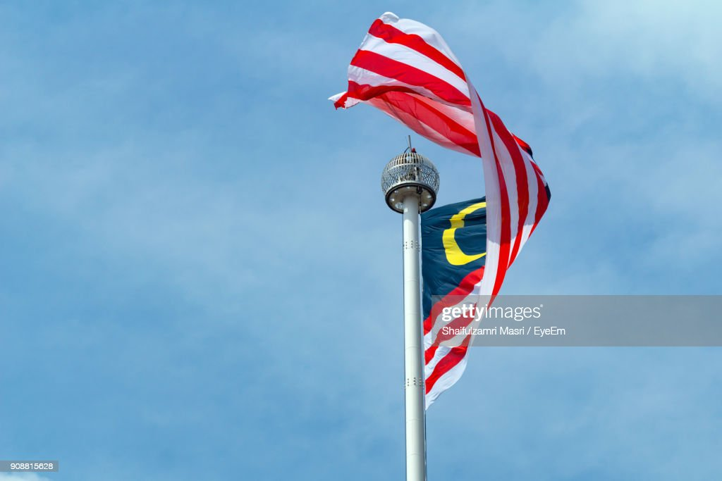 Low Angle View Of Flag Against Blue Sky : Stock Photo