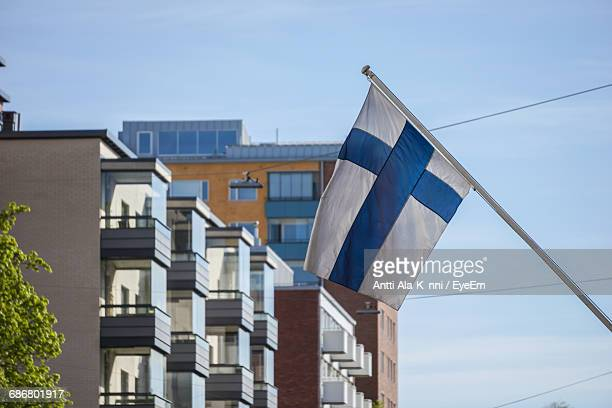 Low Angle View Of Flag Against Building And Sky