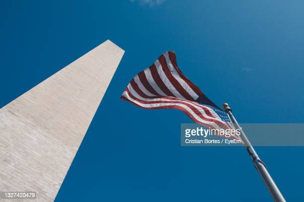 low angle view of flag against clear blue sky - bortes stock pictures, royalty-free photos & images