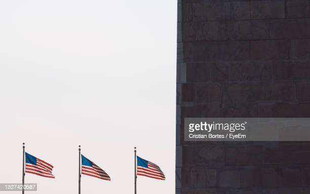 low angle view of flag against clear sky - bortes stock pictures, royalty-free photos & images