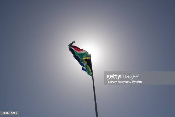 low angle view of flag against clear sky - south african flag stock photos and pictures