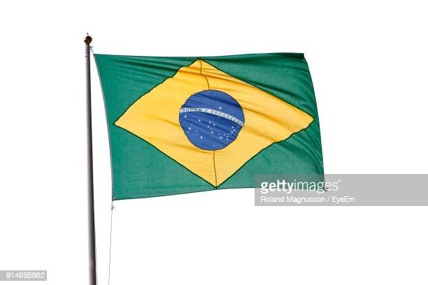low angle view of flag against clear sky - flagpole stock pictures, royalty-free photos & images