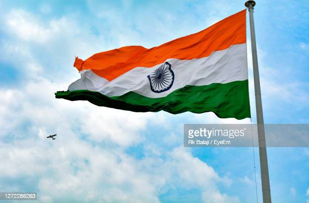 low angle view of flag against sky - 1947 stock pictures, royalty-free photos & images