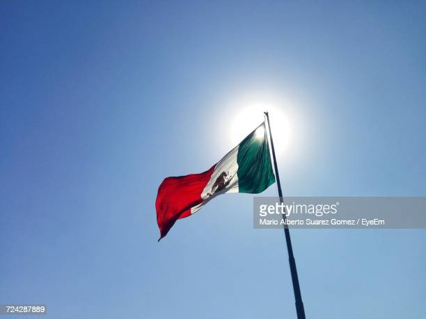 low angle view of flag against sky - bandera mexicana fotografías e imágenes de stock