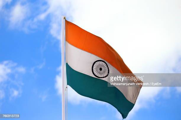 low angle view of flag against sky - indian flag stock pictures, royalty-free photos & images