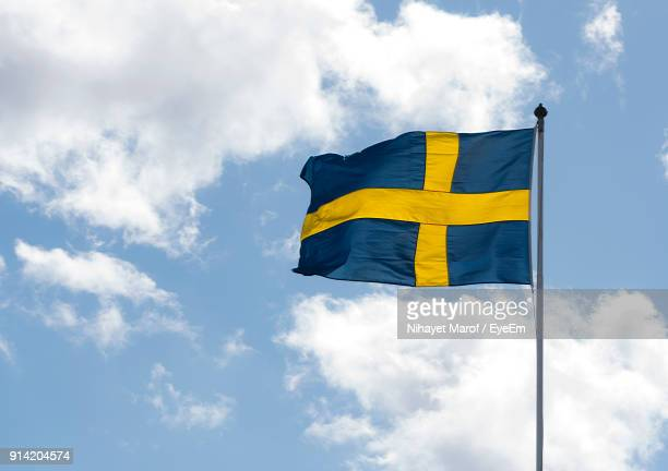 low angle view of flag against sky - sweden stock pictures, royalty-free photos & images
