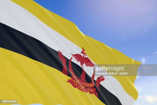 low angle view of flag against sky - brunei stock pictures, royalty-free photos & images