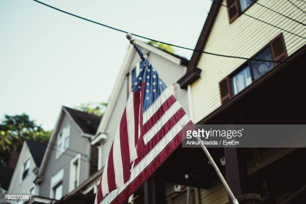 Low Angle View Of Flag On House Against Sky