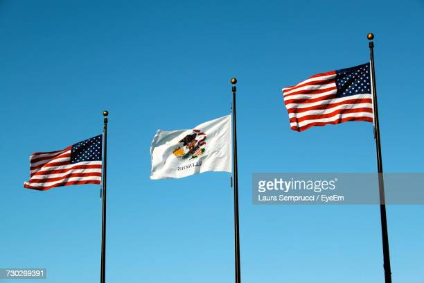 low angle view of flags against clear blue sky - cook county illinois stock photos and pictures
