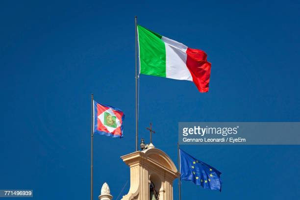 low angle view of flags against clear blue sky - italian flag stock pictures, royalty-free photos & images