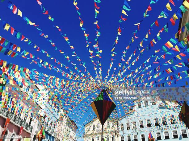 low angle view of flags hanging against sky - south america stock pictures, royalty-free photos & images