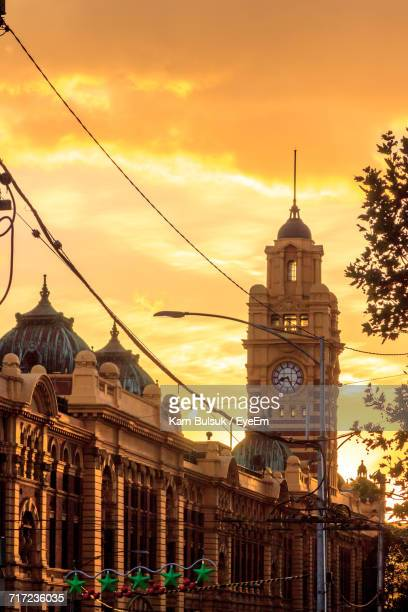 Low Angle View Of Flinders Street Station Against Orange Sky During Sunset