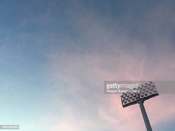 Low Angle View Of Floodlight Against Sky During Sunset