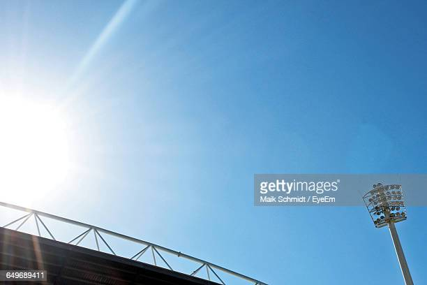 Low Angle View Of Floodlight At Stadium Against Blue Sky