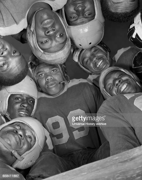 Low Angle View of Football Players in Huddle BethuneCookman College Daytona Beach Florida USA Gordon Parks for Office of War Information January 1943