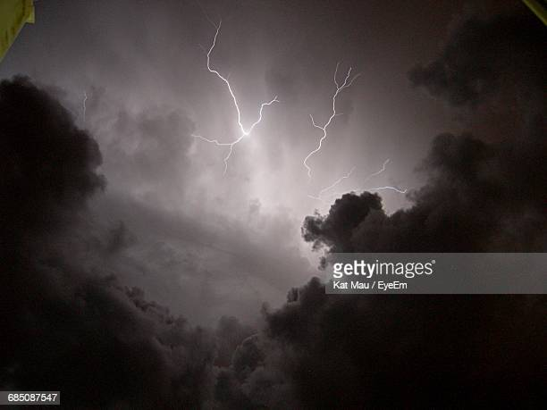 Low Angle View Of Forked Lightning In Cloudy Sky
