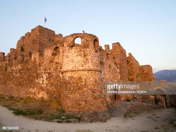 low angle view of fort against sky - mytilene stock photos and pictures