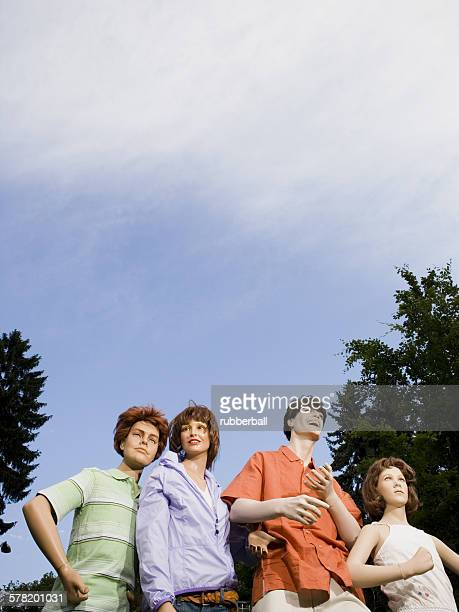 low angle view of four mannequins portraying a family - futurista ストックフォトと画像