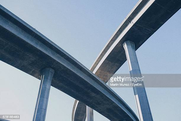 low angle view of freeway against clear sky - flyover stock pictures, royalty-free photos & images