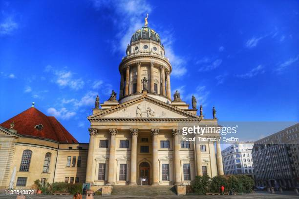 low angle view of french cathedral against blue sky - französischer dom stock pictures, royalty-free photos & images