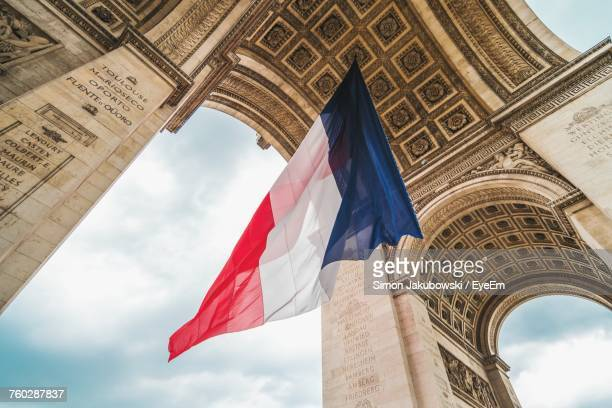 low angle view of french flag - franse cultuur stockfoto's en -beelden