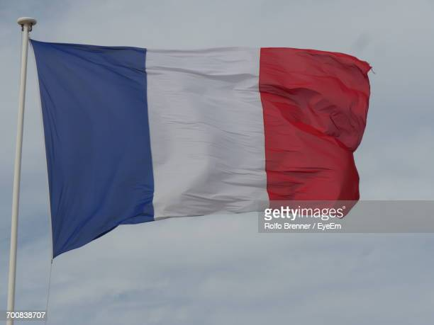 Low Angle View Of French Flag Waving Against Sky