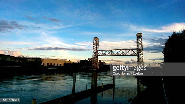 Low Angle View Of Fruitvale Bridge Over River Against Blue Sky At Dusk