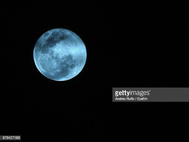 low angle view of full moon against clear sky - andres ruffo stock pictures, royalty-free photos & images