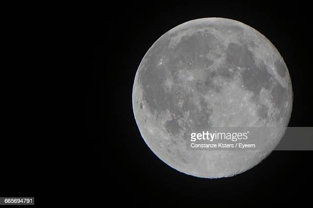 Low Angle View Of Full Moon In Clear Sky At Night