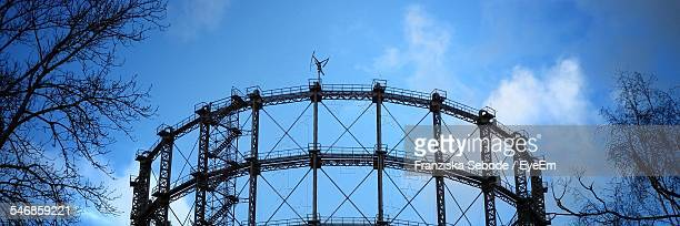 Low Angle View Of Gasometer Against Blue Sky