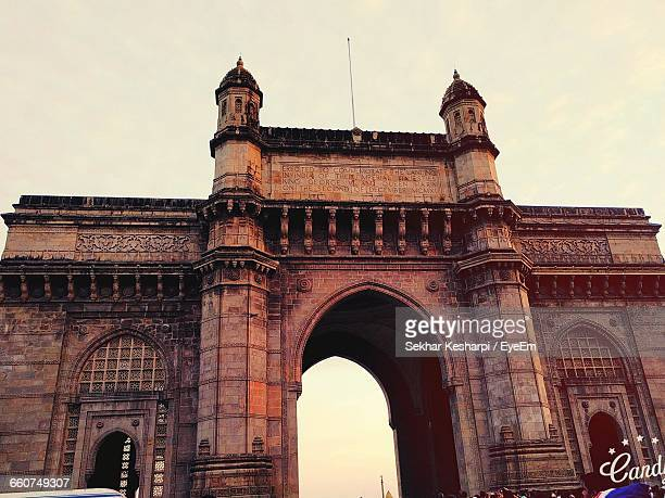 Low Angle View Of Gateway To India Against Sky In City