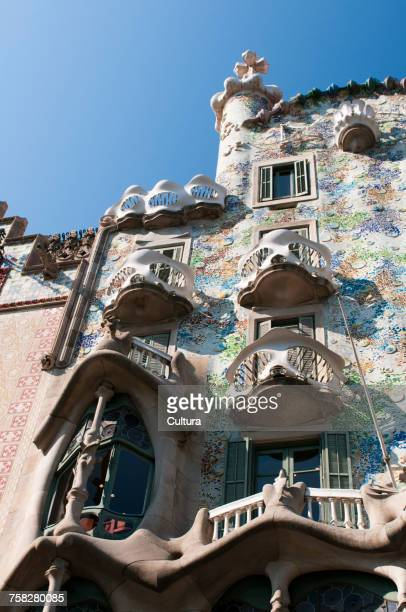 Low angle view of Gaudi's Casa Batllo facade against blue sky