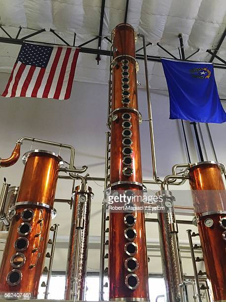 Low Angle View Of Gauge On Copper Stills In Distillery
