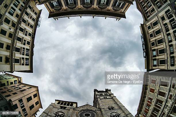Low Angle View Of Genoa Cathedral And Buildings Against Cloudy Sky