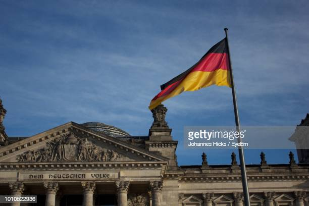 Low Angle View Of German Flag Against Historical Building