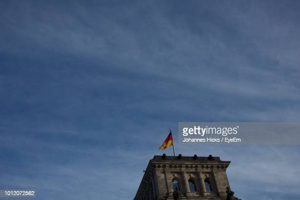 Low Angle View Of German Flag On Historical Building