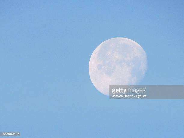 low angle view of gibbous moon in clear blue sky - day ストックフォトと画像