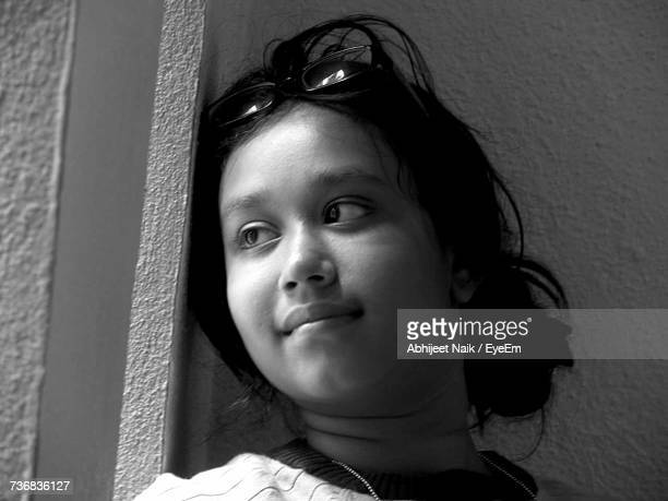 Low Angle View Of Girl Against Wall