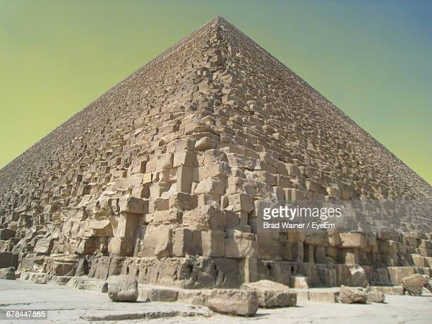 Low Angle View Of Giza Pyramid Against Clear Sky During Sunset