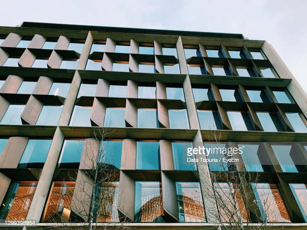 low angle view of glass building against clear sky - data topuria stock pictures, royalty-free photos & images