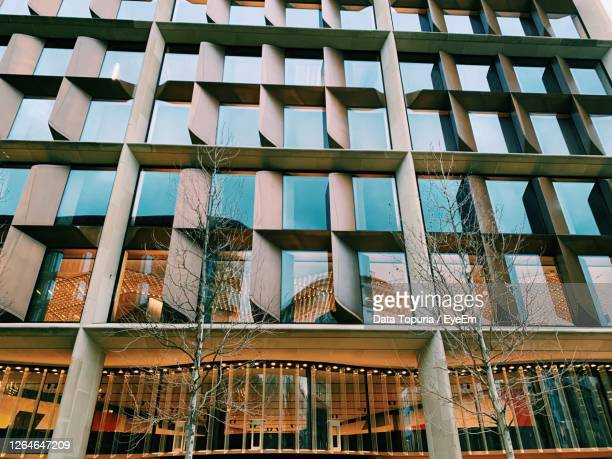 low angle view of glass building against sky - data topuria stock pictures, royalty-free photos & images