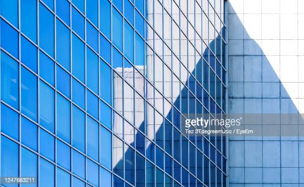 low angle view of glass building - geneva switzerland stock pictures, royalty-free photos & images