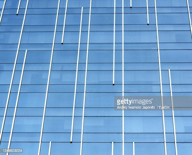 low angle view of glass building - japonês stock pictures, royalty-free photos & images